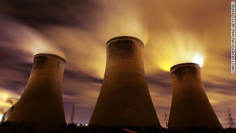 The coal fueled Fiddlers Ferry power station emits vapor into the night sky on November 16, 2009 in Warrington, United Kingdom.