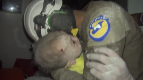 White Helmet volunteer sobs as he rescues baby girl