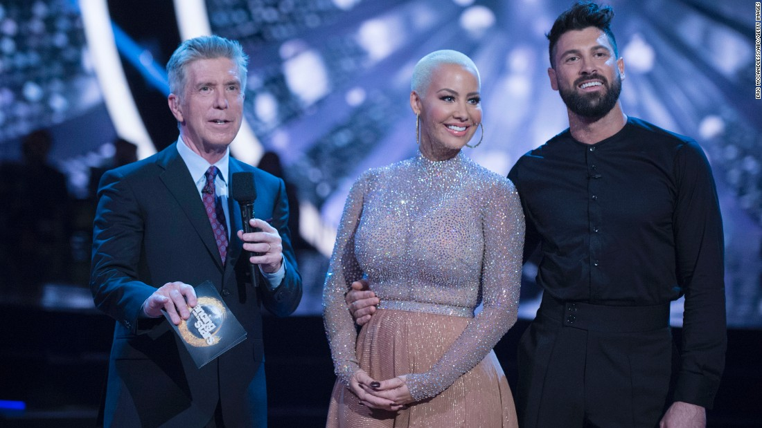 """Dancing with the Stars"" contestant Amber Rose said she felt body shamed by judge Julianne Hough during her week 3 performance. Rose is shown here with co-host Tom Bergeron and partner Maksim Chmerkovskiy."