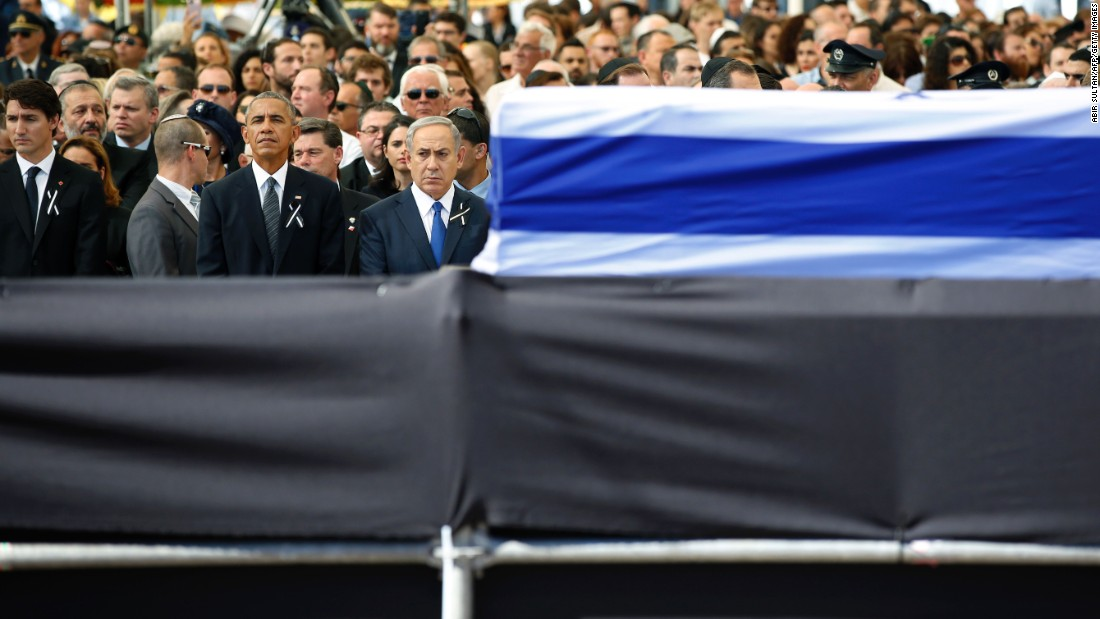 "U.S. President Barack Obama stands beside Israeli Prime Minister Benjamin Netanyahu, front right, at <a href=""http://www.cnn.com/2016/09/30/middleeast/gallery/shimon-peres-funeral/index.html"" target=""_blank"">the funeral of former Israeli President Shimon Peres</a> on Friday, September 30. Peres, who shared a Nobel Prize for forging a peace deal between Israelis and Palestinians, <a href=""http://www.cnn.com/2016/09/27/middleeast/shimon-peres-obit/"" target=""_blank"">died Wednesday</a> at the age of 93."