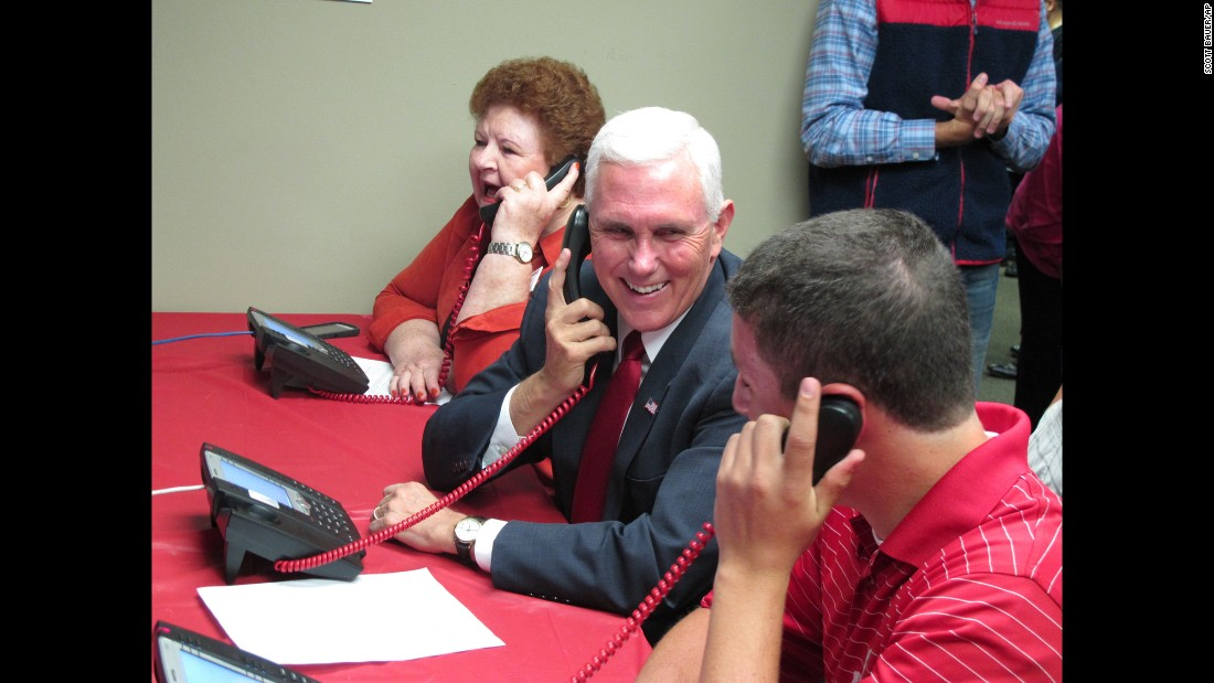 Indiana Gov. Mike Pence, Donald Trump's running mate, makes phone calls at a Republican Party office in Fitchburg, Wisconsin, on Tuesday, September 27.