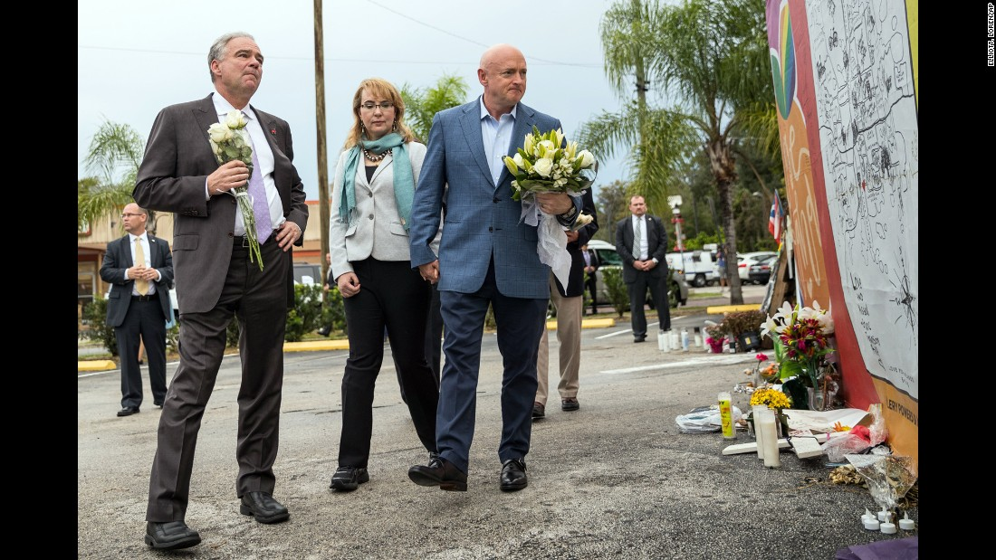 "U.S. Sen. Tim Kaine, left, joins former U.S. Rep. Gabby Giffords and her husband, Mark Kelly, at a memorial site for victims of the <a href=""http://www.cnn.com/interactive/2016/06/us/cnnphotos-orlando-portraits/"" target=""_blank"">Pulse nightclub shooting</a> in Orlando. They made the visit on Monday, September 26 -- more than two months after the worst mass shooting in U.S. history."