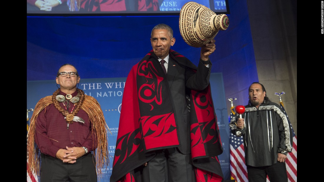 U.S. President Barack Obama wears a traditional blanket and hat given to him during the White House Tribal Nations Conference on Monday, September 26.
