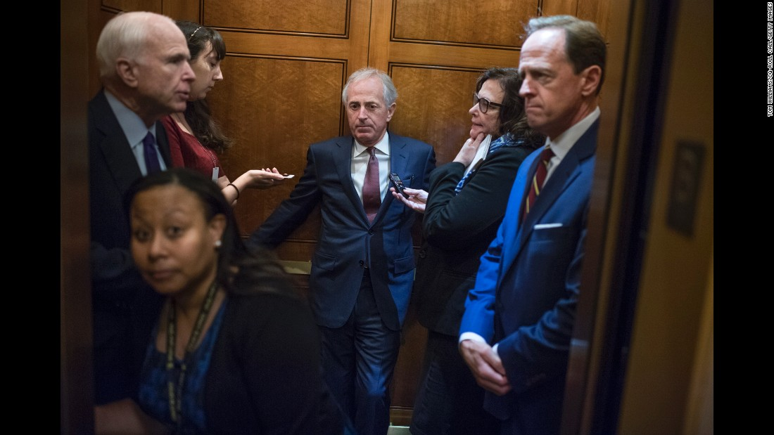 From left, U.S. Sens. John McCain, Bob Corker and Pat Toomey ride a Capitol elevator on Wednesday, September 28.