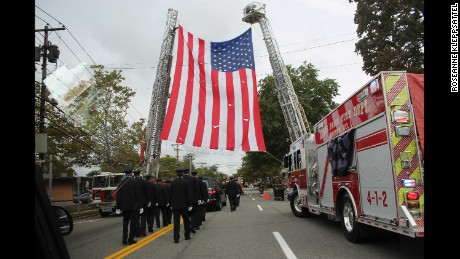 Kings Park firefighters in Kleppsattel's funeral procession