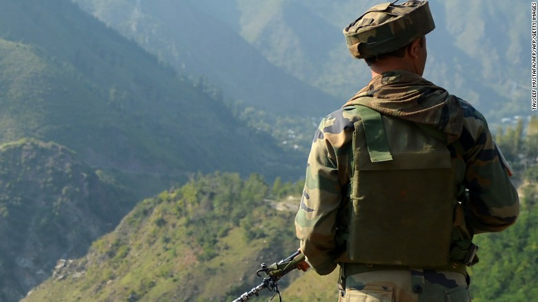 An Indian army soldier looks towards the site of a gunbattle between Indian army soldiers and rebels inside an army brigade headquarters near the border with Pakistan, known as the Line of Control (LoC), in Uri on September 18, 2016. Militants armed with guns and grenades killed 17 soldiers in a raid September 18 on an army base in Indian-administered Kashmir, the worst such attack for more than a decade in the disputed Himalayan region. / AFP / TAUSEEF MUSTAFA        (Photo credit should read TAUSEEF MUSTAFA/AFP/Getty Images)