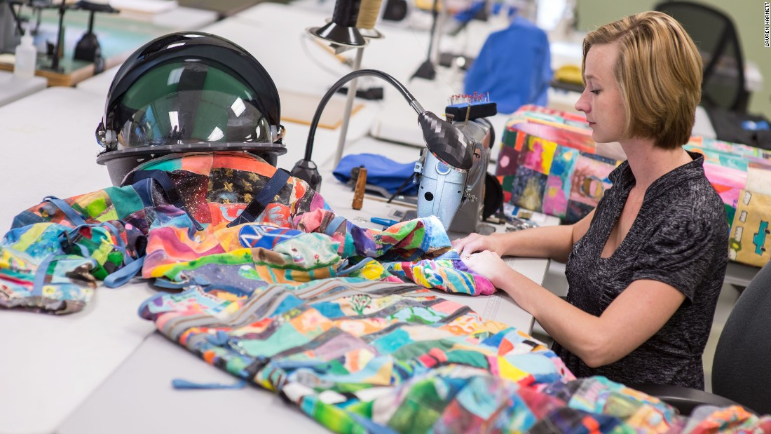 Whitney Lowery, a NASA space suit technician with ILC Dover, works on sewing art pieces to build the children's space suit replicas for the project. The art pieces will be combined to create the space suit replica call Unity.