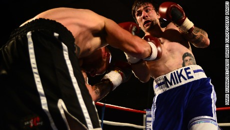 Boxer Mike Towell, right, takes on Danny Little in a 2015 welterweight match in Glasgow, Scotland.