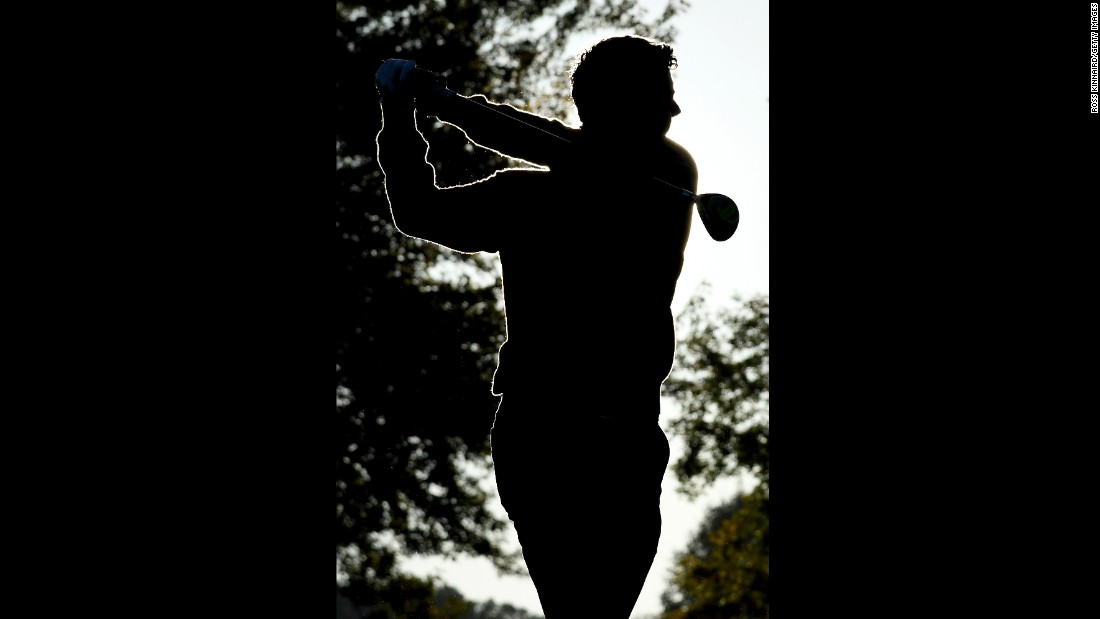 Rory McIlroy of Europe hits off the range during morning foursome matches.