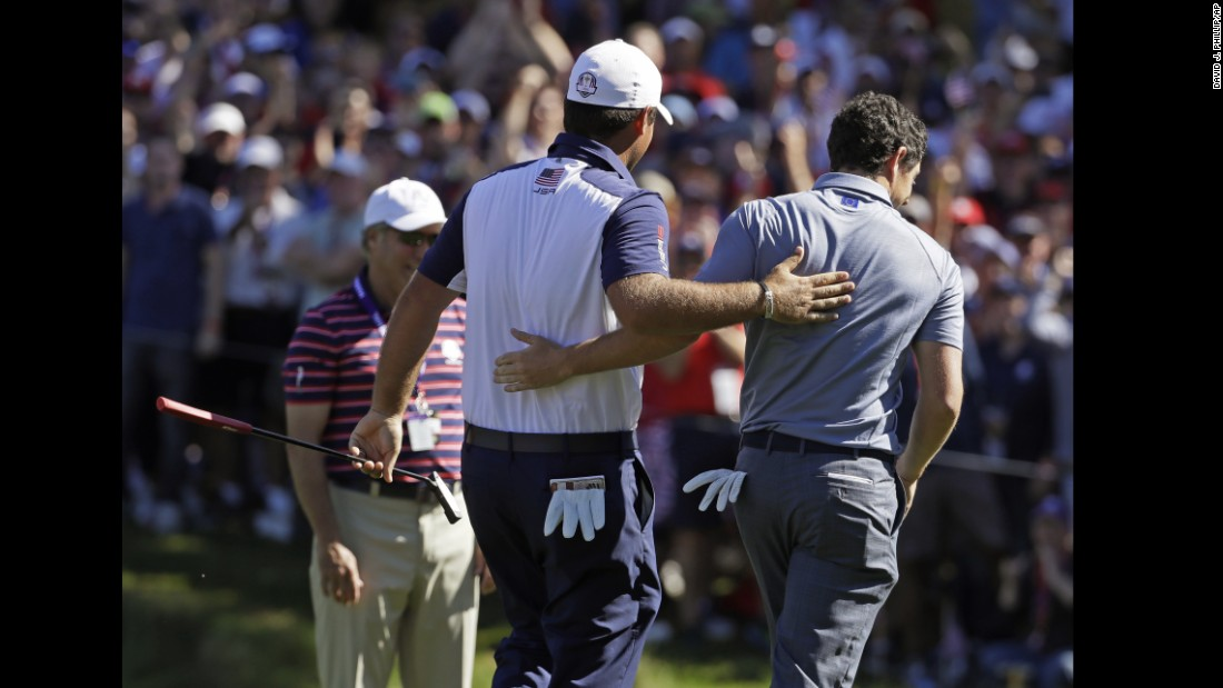 United States' Patrick Reed and Europe's Rory McIlroy walk off the eighth hole together during a singles match.