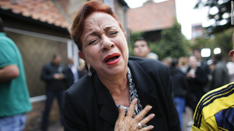 An opponent to the peace deal celebrates after she listened to the results of the referendum to decide whether or not to support a peace accord in Bogota, Colombia.