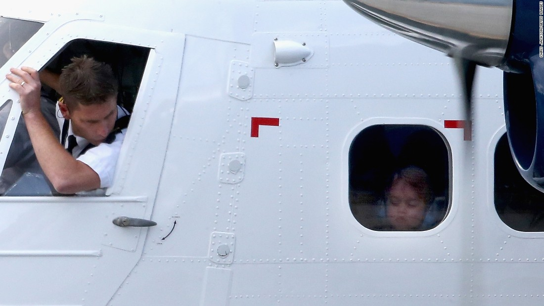 Prince George of Cambridge looks out of the window of a sea-plane in Victoria on October 1.