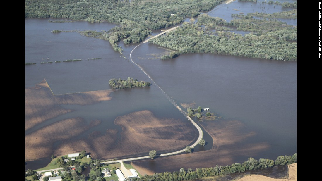 "In eastern Iowa, rising rivers and creeks <a href=""http://www.cnn.com/2016/09/27/us/iowa-wisconsin-flooding/"" target=""_blank"">flooded low-lying fields and properties</a> on Monday, September 26."