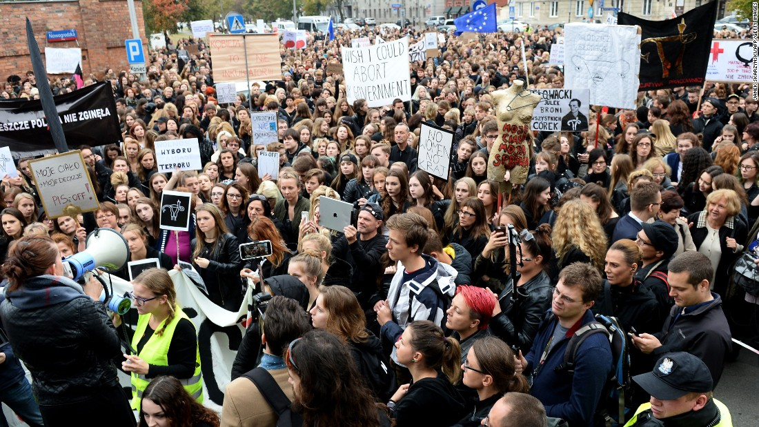 People take part in a nationwide strike and demonstration to protest a legislative proposal for a ban of abortion on Monday, October 3, in Warsaw, Poland.