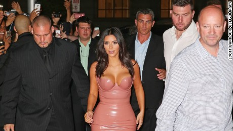 Kim Kardashian West, center, arrives with bodyguard Pascal Duvier, left, at an event in Australia in 2014.