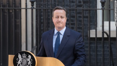 British Prime Minister David Cameron resigns on the steps of 10 Downing Street.