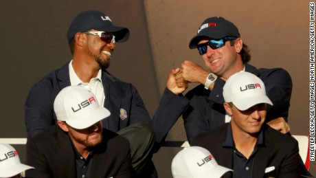Tiger Woods (back left) was a vice-captain alongside Bubba Watson.