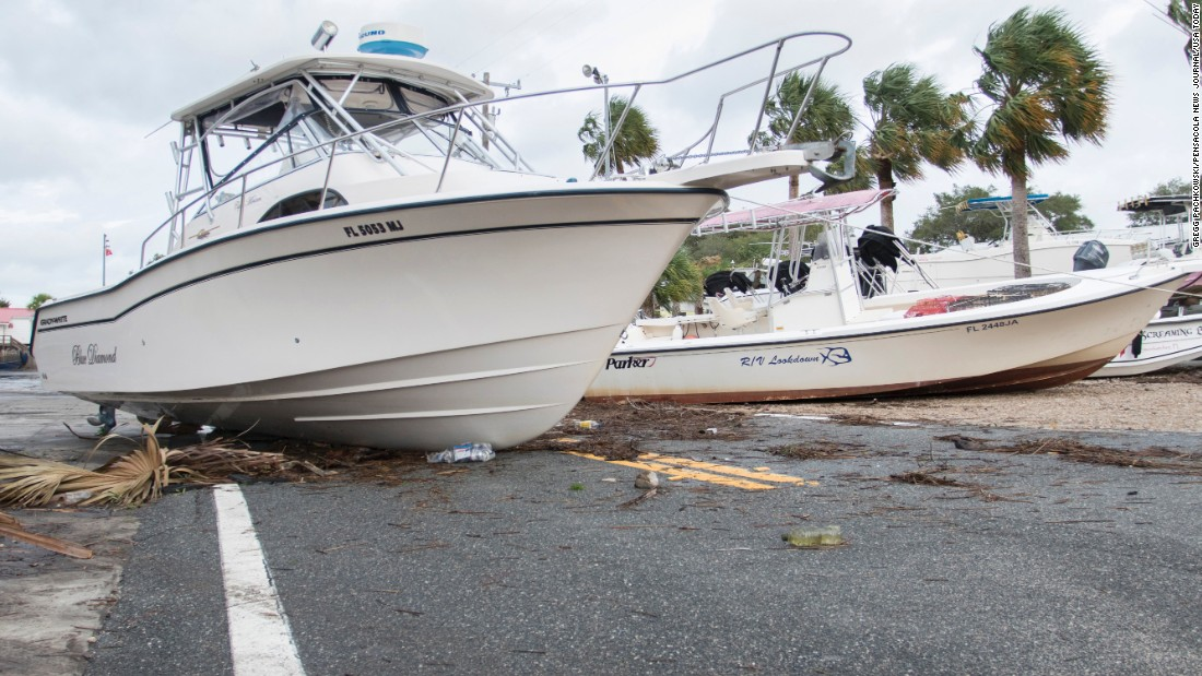 "Boats rest in the middle of a road in Steinhatchee, Florida, after <a href=""http://www.cnn.com/2016/09/01/weather/tropical-storm-hermine/"" target=""_blank"">Hurricane Hermine made landfall</a> on Friday, September 2."