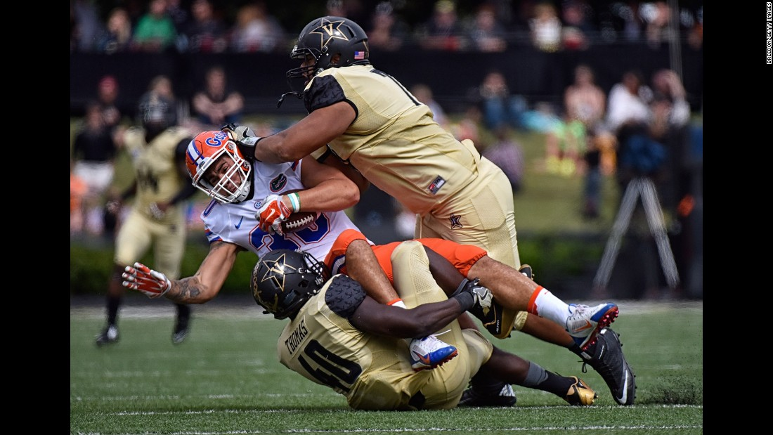 Florida's DeAndre Goolsby is crunched by Vanderbilt's Ja'karri Thomas and Nifae Lealao during a college football game in Nashville, Tennessee, on Saturday, October 1.