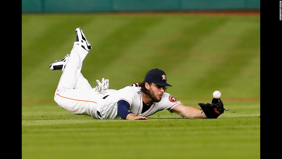 Houston's Jake Marisnick dives for a line drive against Seattle on Tuesday, September 27.