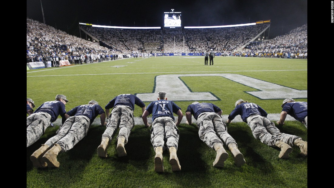 ROTC members from Brigham Young University do pushups after the school's football team scored against Toledo on Friday, September 30.