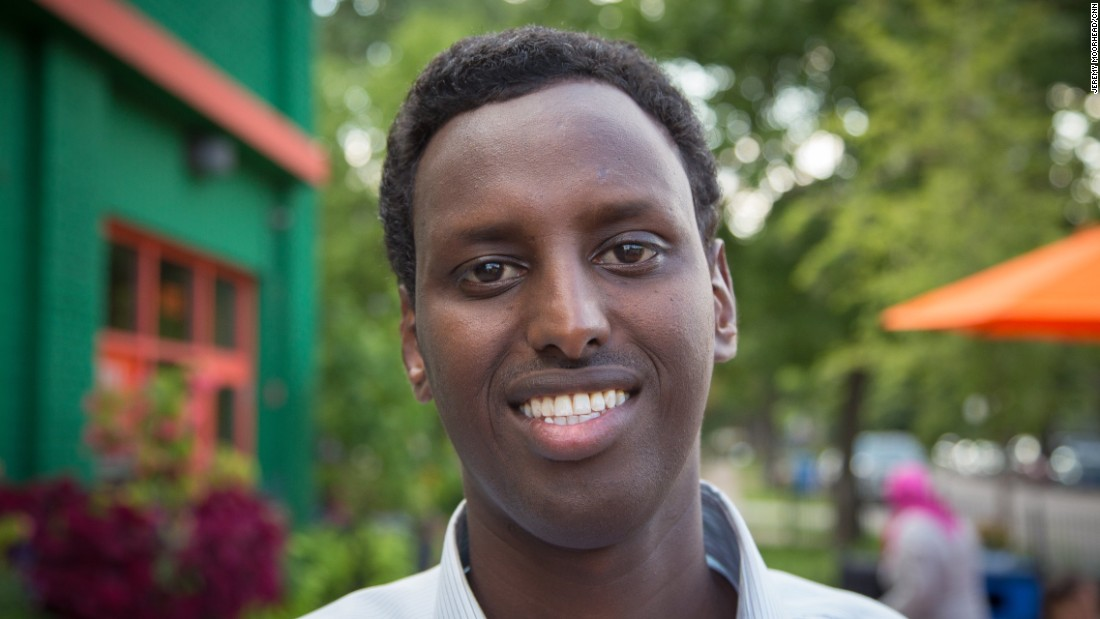 """Hamse Warfa, 37, born in Somalia, came to the U.S. as a teenager, lives in Savage, Minnesota. A social entrepreneur and author of """"America Here I come: A Somali Refugee's Quest for Hope."""" Supporting Hillary Clinton. <br /><br />""""I have never thought I would hear my young daughter say, 'Dad, people were asking me about my scarf in the school.' Same school she's been going last year, the year before, but yet just before school closed she said young students were asking about, 'Hey, you Muslim? Why you have that thing on your hair?' She's turning 9 years old next week.""""<br />"""