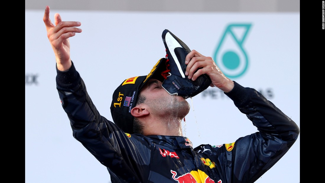 "Formula One driver Daniel Ricciardo drinks from his boot as he celebrates victory in the <a href=""http://www.cnn.com/2016/10/02/motorsport/malaysia-gp/index.html"" target=""_blank"">Malaysian Grand Prix</a> on Sunday, October 2."