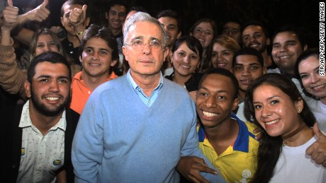 Colombian former President and Senator Alvaro Uribe (C) poses with supporters after a press conference after knowing the results of a referendum on whether to ratify a historic peace accord to end a 52-year war between the state and the communist FARC rebels, in Rionegro, Colombia on October 2, 2016.  Colombian voters rejected a peace deal with communist FARC rebels Sunday, blasting away what the government hoped would be a historic end to a 52-year conflict. / AFP / STR        (Photo credit should read STR/AFP/Getty Images)