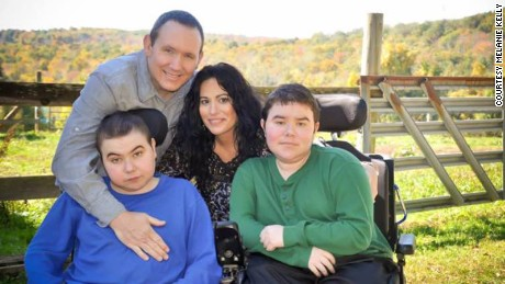 John and Melanie Kelly with their sons, 16-year-old Liam and 19-year-old Jacob.