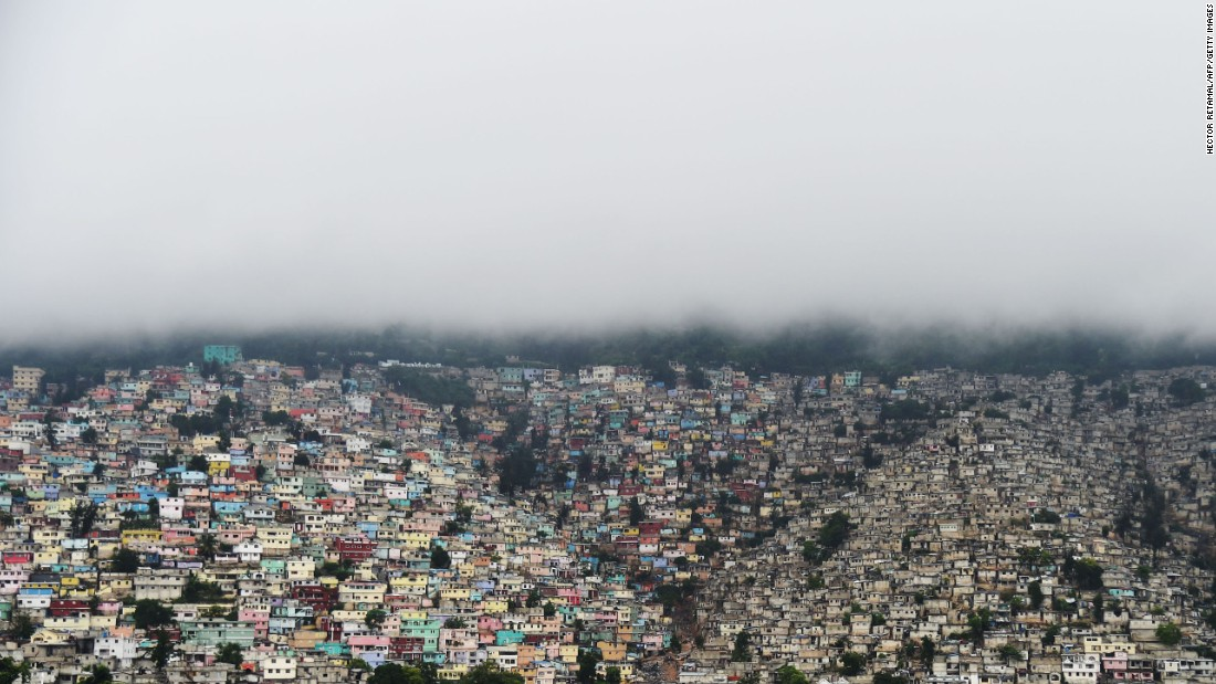 Clouds loom over the hills of the Petionville suburb of Port-au-Prince on October 3.