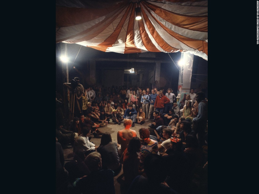 "The height of Kesey's efforts was the Acid Test Graduation, which took place on October 31, 1966. Kesey (center, shirtless) was entangled with legal proceedings against him for marijuana possession and faked suicide, and wanted to go out in a moment in triumph. The test was ostensibly to ""go beyond acid,"" to reach its heightened state sober. In reality everyone took acid with television cameras rolling -- Kesey's last prank with the Pranksters."