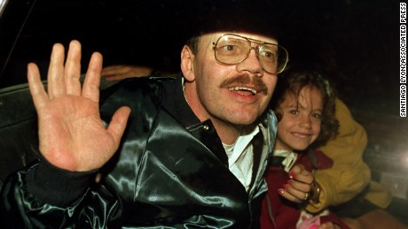 Former hostage Terry Anderson grins with his 6 year old daughter Sulome as they leave the U.S. Ambassador's residence in Damascus early Thursday, Dec. 4, 1991 to board a plane to Germany. Sulome was born three months after Anderson was kisnapped in Beirut nearly seven years ago. (AP Photo/Santiago Lyon)