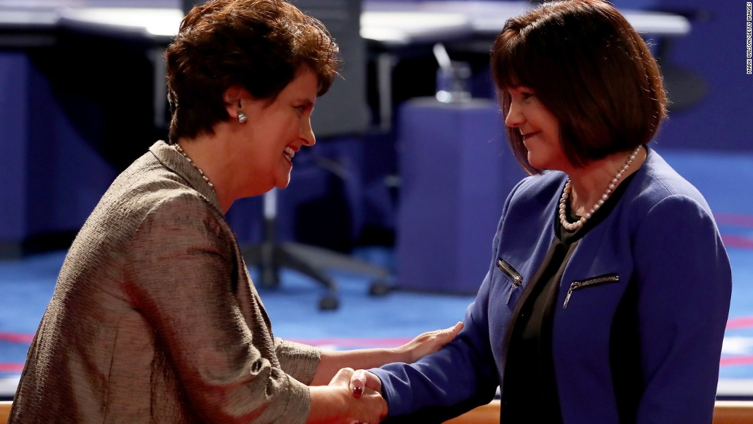 Kaine's wife, Anne Holton, greets Karen Pence, right, before the debate.