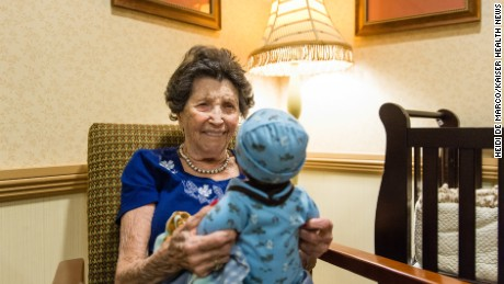 Vivian Guzofsky, 88, holds a baby at Sunrise Senior Living in Beverly Hills, California.