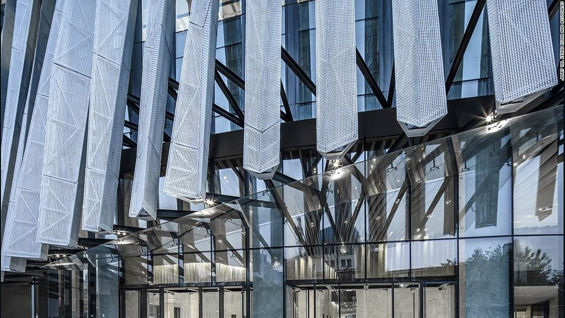 "Aluminum mesh ""pleats"" wrap around the whole building, like a lace dress for women. It gives a  different look for from different angles."