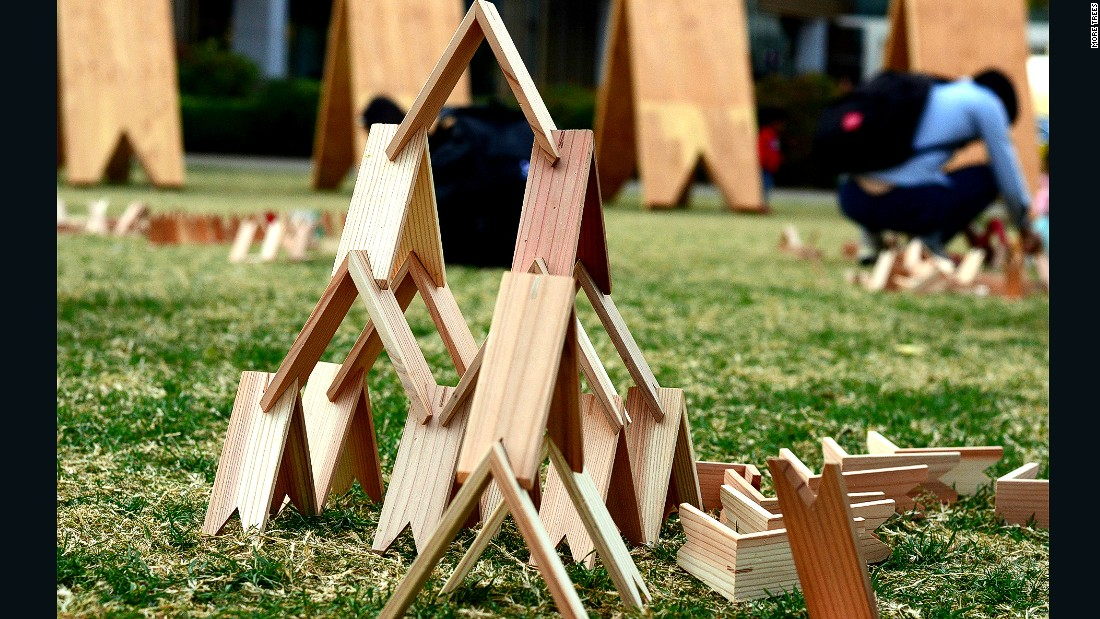 "Kuma's fascination with layering wood was evident when he created Tsumiki (meaning ""wodden blocks"" in Japanese). This simple triangle-shaped children's toy was dubbed the Japanese version of Lego."