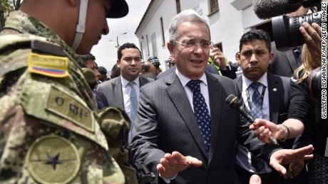 Colombian former president and current senator Alvaro Uribe arrives at Narino Palace in Bogota for a meeting with Colombian President Juan Manuel Santos on October 5, 2016. Colombian President Juan Manuel Santos was meeting top opponents of his failed peace deal with the FARC rebels Wednesday after setting an end-of-the-month deadline to salvage the peace process or return to war. Voters on Sunday rejected the peace deal with the leftist guerrillas.   / AFP / Guillermo LEGARIA        (Photo credit should read GUILLERMO LEGARIA/AFP/Getty Images)