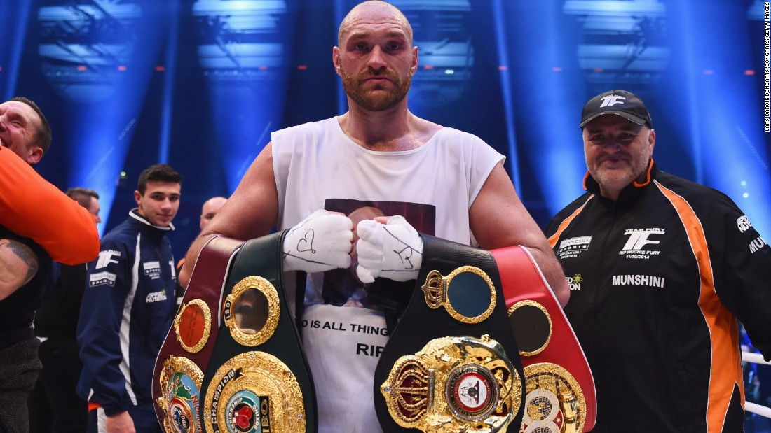 Tyson Fury celebrates with his belts after beating Wladimir Klitschko to become new world heavyweight champion.