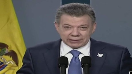 cnnee brk paz colombia sot santos reunion uribe_00064225
