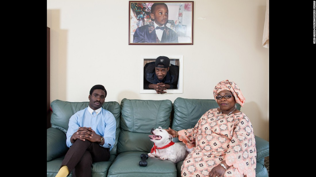 "Joe Arojojoye, left, is from Nigeria, as are his mother, Adebimpe Ogunmokun, and his brother Michael Ashaolu. Photographing Londoners in their homes was something Steele-Perkins knew he wanted to do from the very beginning of his project. ""I wanted the idea that they belonged here,"" he said. ""They had a home. These weren't tourists. It wasn't standing in Trafalgar Square or something like that."""