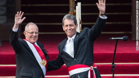 "Peru's President Pedro Pablo Kuczynski (L) and his Economy Minister Alfredo Thorne wave at the Government Palace in Lima on July 28, 2016.   Kuczynski, who was sworn in as president of Peru, says he will hit the ground running after a long career as a Wall Street banker that gave him the moniker ""El Gringo"". Kuczynski, 77, defeated Keiko Fujimori, the daughter of a jailed former president, in a hard-fought presidential election last month that was decided by a razor-thin margin. / AFP / ERNESTO BENAVIDES        (Photo credit should read ERNESTO BENAVIDES/AFP/Getty Images)"