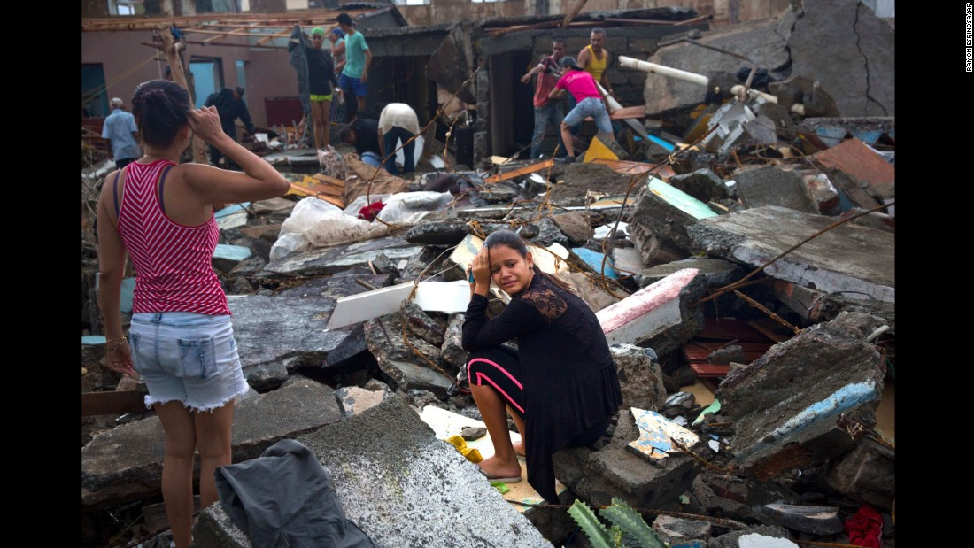 A woman cries amid the rubble of her home in Baracoa.