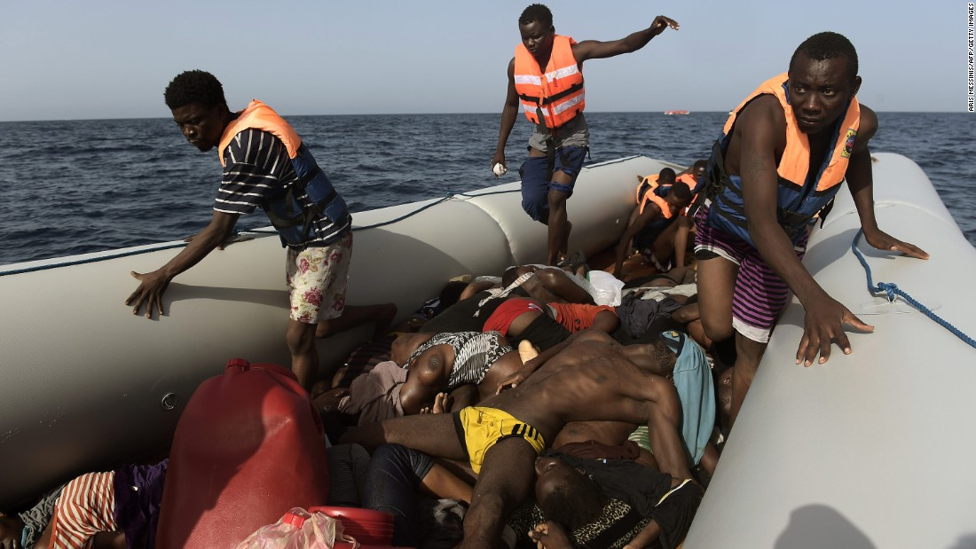 "Migrants step over dead bodies while being rescued in the Mediterranean Sea, off the coast of Libya on Tuesday, October 4.  Agence France-Presse photographer Aris Messinis <a href=""http://www.cnn.com/2016/10/06/europe/migrant-boats-libya-aris-messinis/index.html"" target=""_blank"">was on a Spanish rescue boat</a> that encountered several crowded migrant boats. Messinis said the rescuers counted 29 dead bodies -- 10 men and 19 women, all between 20 and 30 years old. ""I've (seen) in my career a lot of death,"" he said. ""I cover war zones, conflict and everything. I see a lot of death and suffering, but this is something different. Completely different."""