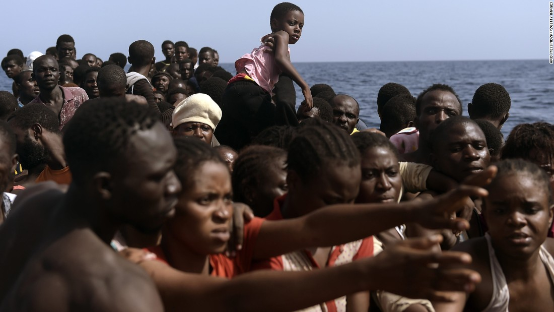 Migrants wait to be rescued.