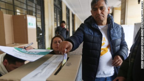 BOGOTA, COLOMBIA - OCTOBER 02:  A voter casts his ballot in the referendum on a peace accord to end the 52-year-old guerrilla war between the FARC and the state on October 2, 2016 in Bogota, Colombia. The guerrilla war is the longest-running armed conflict in the Americas and has left 220,000 dead. The plan calls for a disarmament and re-integration of most of the estimated 7,000 FARC fighters.  (Photo by Mario Tama/Getty Images)