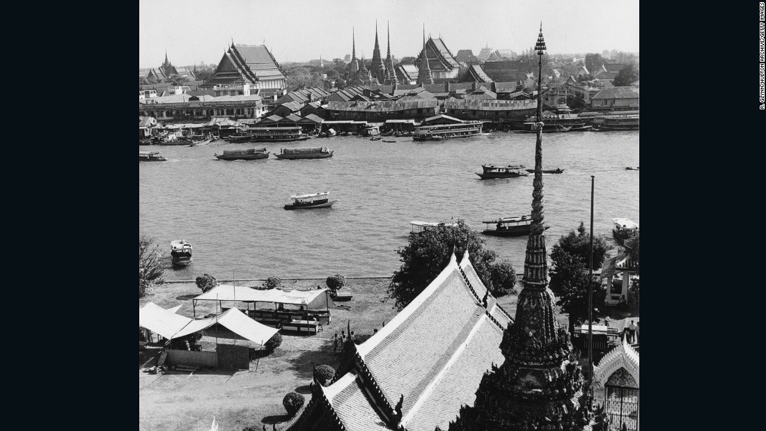 A view across the Chao Phraya River in Bangkok, with the Royal Palace in the background.