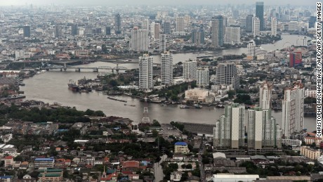 This aerial picture taken on April 5, 2014 shows a general view of the skyline and the Chao Phraya river passing through Bangkok. The World Bank on April 7 said developing countries in East Asia will grow 7.1 percent in 2014 as they benefit from a stabilising global economy and withstand the impact of US stimulus cuts. However, the report said larger Southeast Asian economies, including Indonesia and Thailand, will face tougher global financial conditions and higher levels of household debt.  AFP PHOTO / Christophe ARCHAMBAULT        (Photo credit should read CHRISTOPHE ARCHAMBAULT/AFP/Getty Images)
