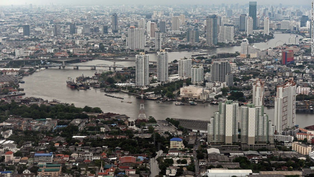 This aerial picture taken on April 5, 2014 shows a general view of the skyline and the Chao Phraya river passing through Bangkok. Although beset by regular political and economic troubles, the Thai capital has expanded rapidly, reflecting the nation's recent strong economic growth.