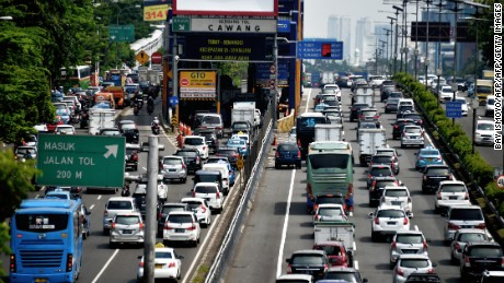 A general view shows traffic commuting on a congested road in Jakarta on June 2, 2016.