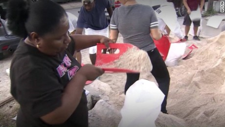 Daytona Beach residents fill sandbags Thursday.